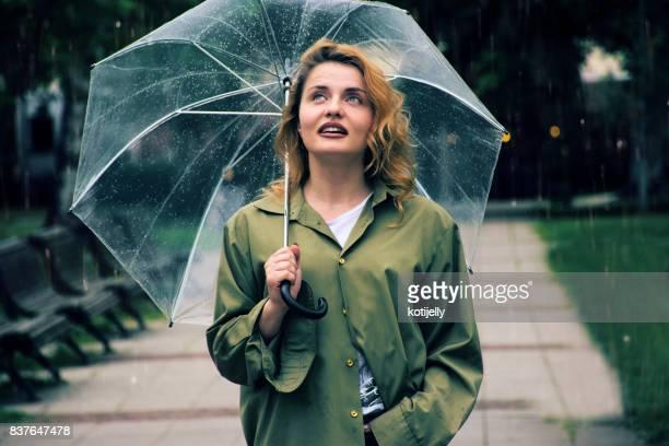 Young woman enjoying the rain