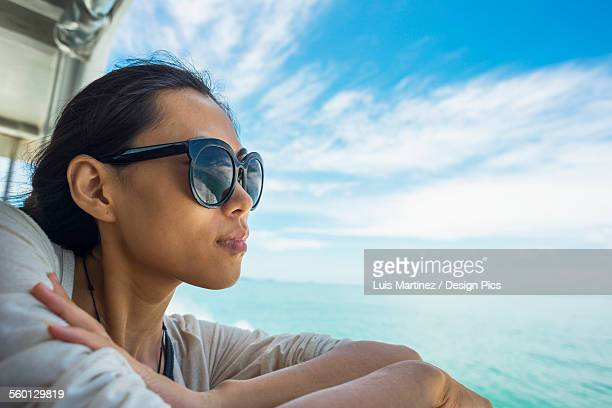 A young woman enjoying the seascape on the way to Koh Rong island by ferry