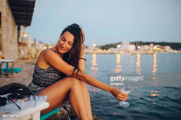 young woman enjoying the summertime by the sea - butlins stock pictures, royalty-free photos & images