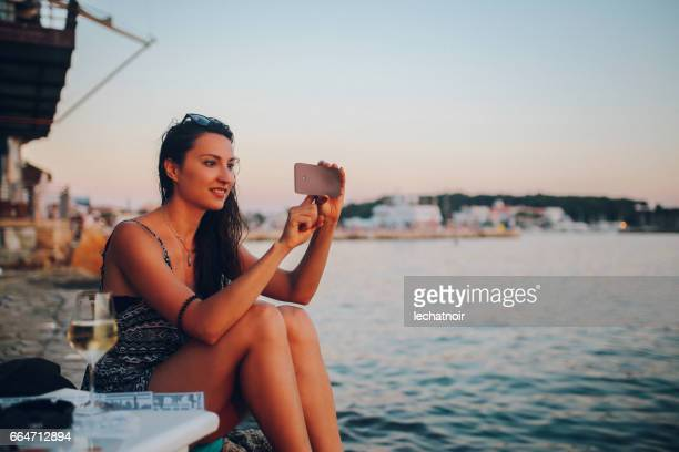young woman enjoying the summertime by the sea - cross processed stock pictures, royalty-free photos & images
