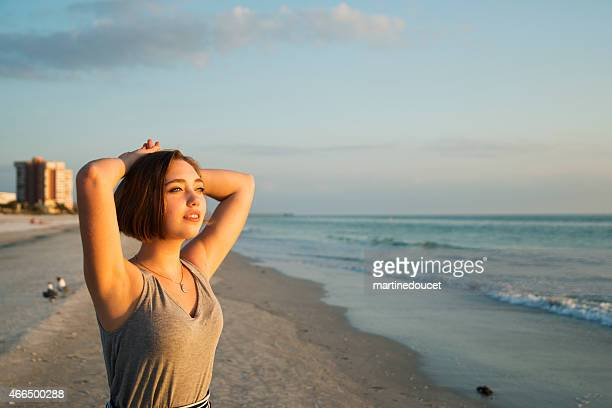 "young woman enjoying the sunset at the beach. - ""martine doucet"" or martinedoucet bildbanksfoton och bilder"