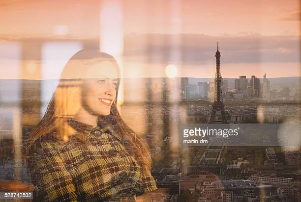 Young woman enjoying the sunset in Paris