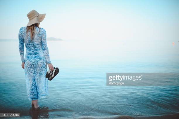 Young woman enjoying the view during her vacation in Greece
