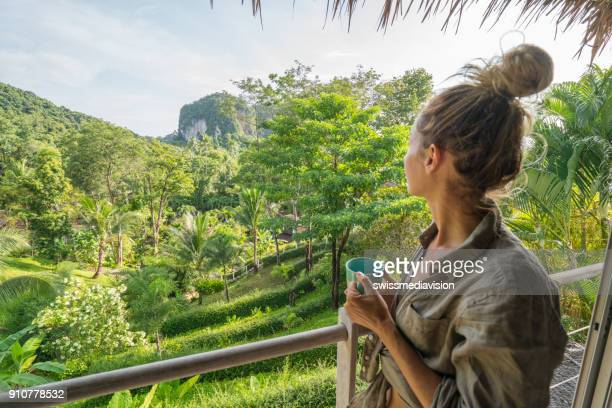 young woman enjoying the view from tree house, thailand - eco tourism stock pictures, royalty-free photos & images