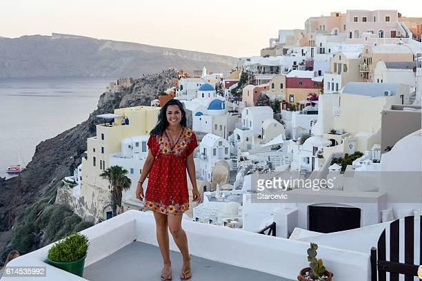 Young woman enjoying the views of Santorini Island - Greece