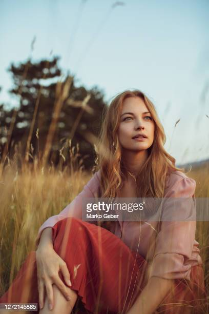 young woman enjoying time in nature - fashion model stock-fotos und bilder