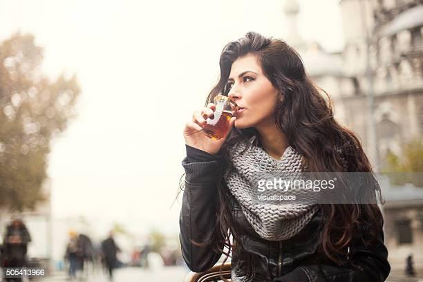 Young Woman Enjoying Turkish Tea Outdoors