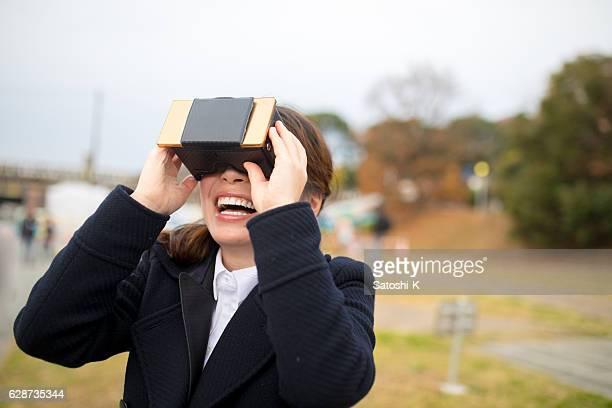 Young woman enjoying with virtual reality simulator