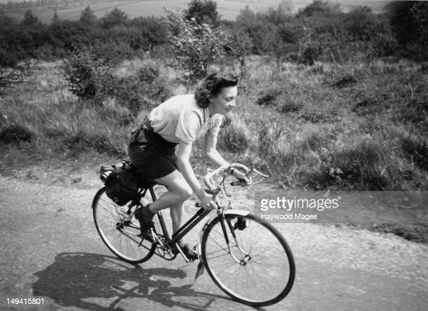 A young woman enjoys a day out on her bicycle in Surrey 1948 Original Publication Picture Post 4563 A Nice Day's Outing pub 19th June 1948
