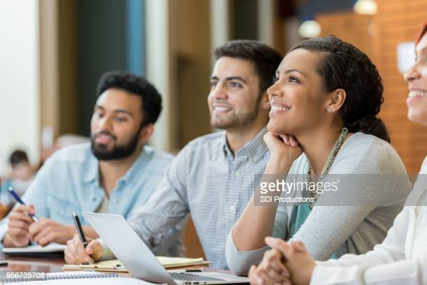 Young woman enjoys exciting university lecture