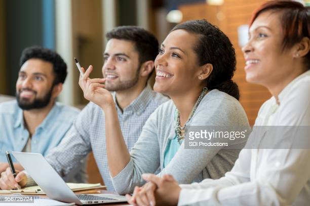 Young woman enjoys humorous university lecture