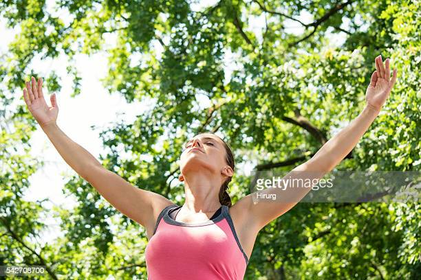 Young woman enjoys in nature and fresh air