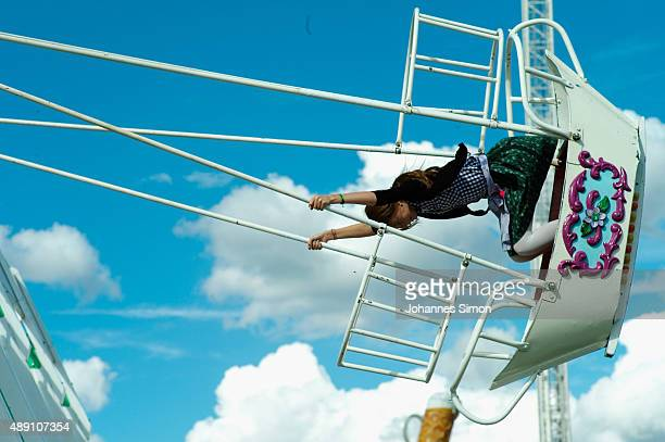 Young woman enjoys riding a swingboat during the opening day of the 2015 Oktoberfest on September 19, 2015 in Munich, Germany. The 182nd Oktoberfest...