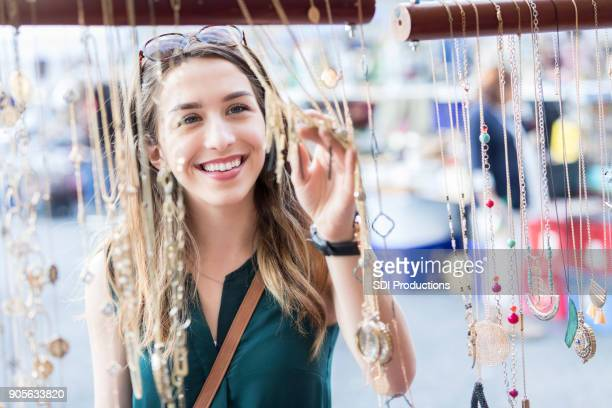 Young woman enjoys shopping in New York City