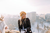 Young woman enjoys snowy winter