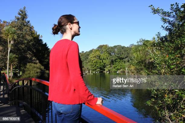 young woman enjoys the landscape view of a public park - rafael ben ari 個照片及圖片檔