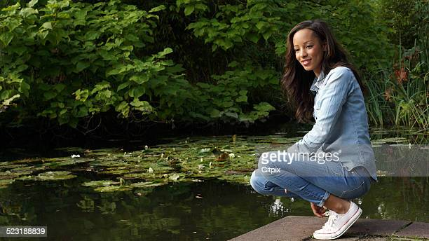 Young woman enjoys the nature