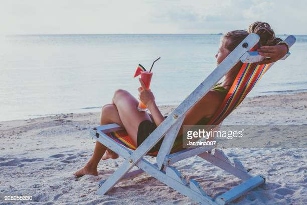 Young woman enjoys vacations