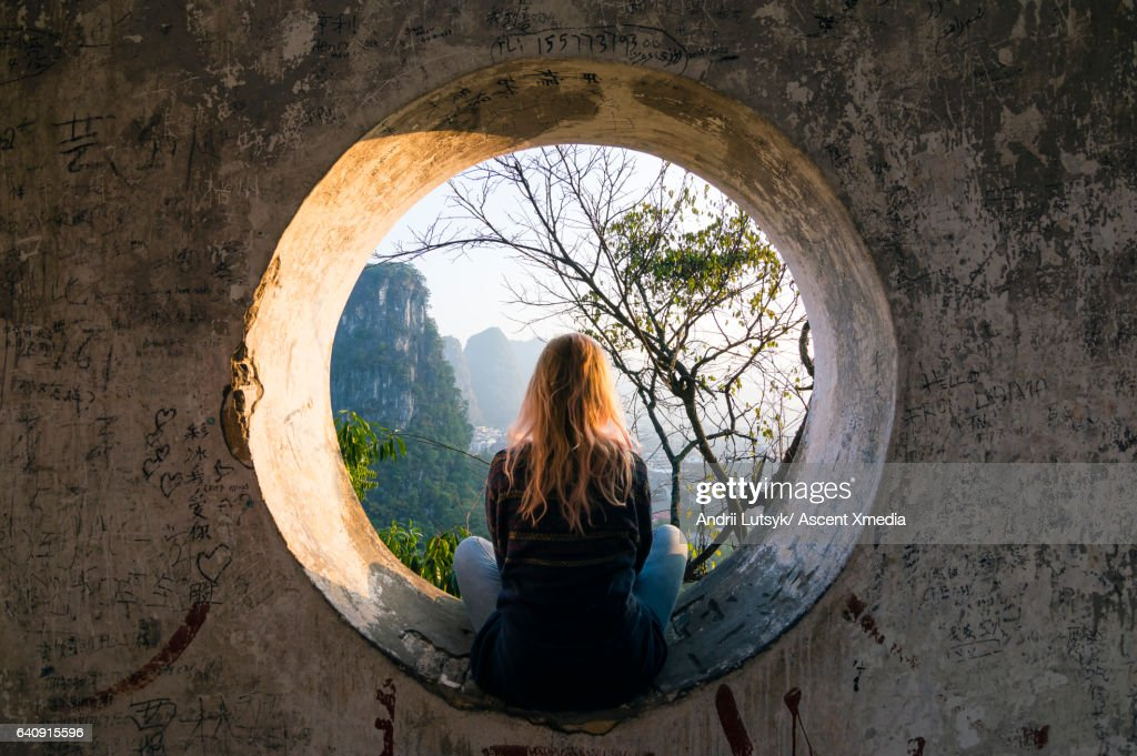 Young woman enjoys view over Yangshuo, karst mountains : Stock Photo