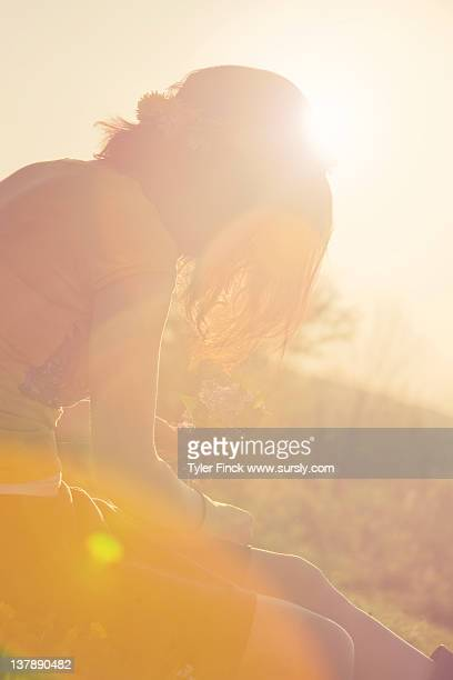 young woman enjoys warm sun - sursly stock pictures, royalty-free photos & images