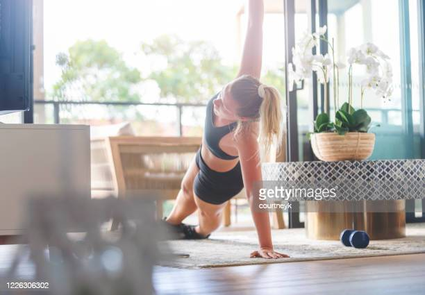 young woman exercising at home. - cardiovascular exercise stock pictures, royalty-free photos & images
