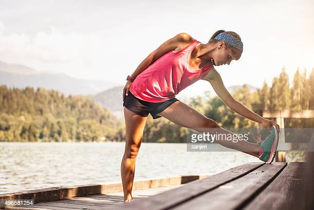 young woman exercising fitness in nature - daily sport girls stock pictures, royalty-free photos & images