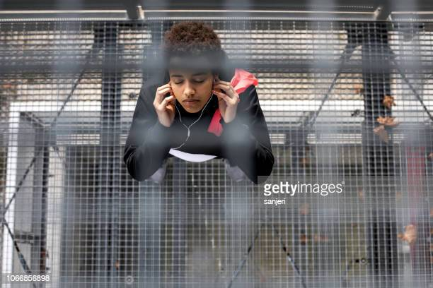 young woman exercising in an urban environment - center athlete stock pictures, royalty-free photos & images