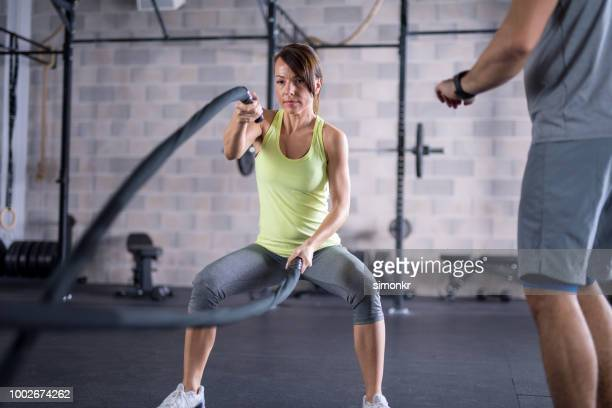 young woman exercising in gym - pedal pushers stock pictures, royalty-free photos & images