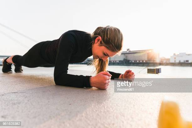 young woman exercising in the city at sunet - plank stock pictures, royalty-free photos & images