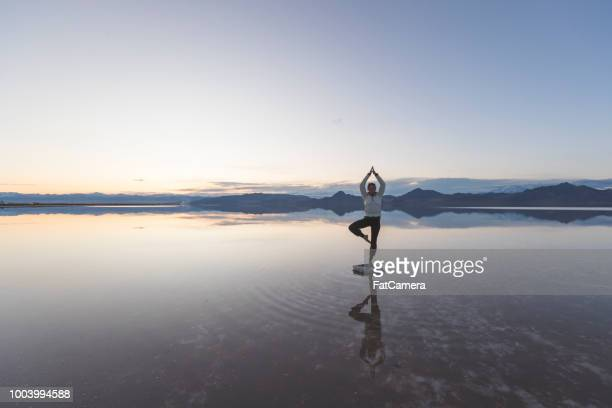 young woman exercising in the utah salt flats - self improvement stock pictures, royalty-free photos & images