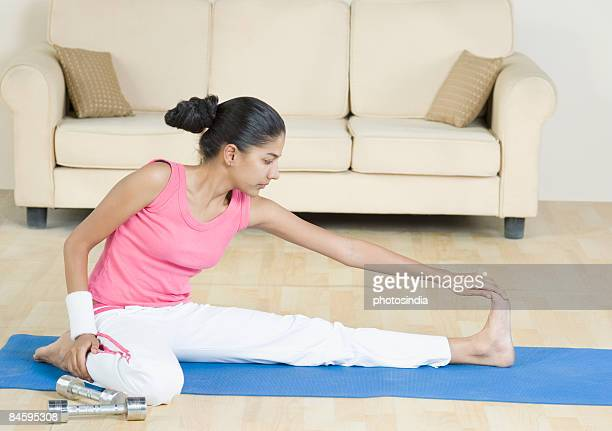 Young woman exercising on an exercise mat