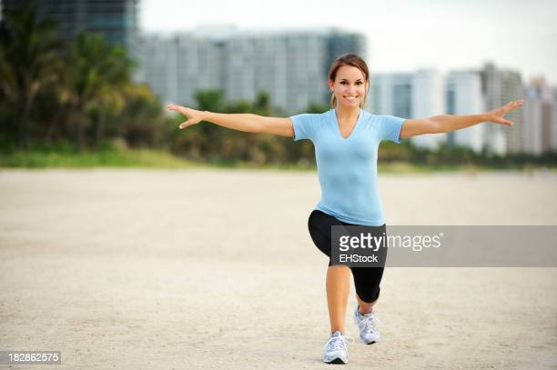 Young Woman Exercising on Beach