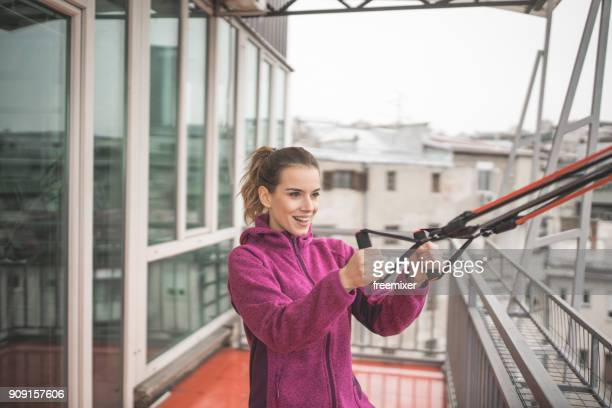 young woman exercising - elastic bandage stock photos and pictures