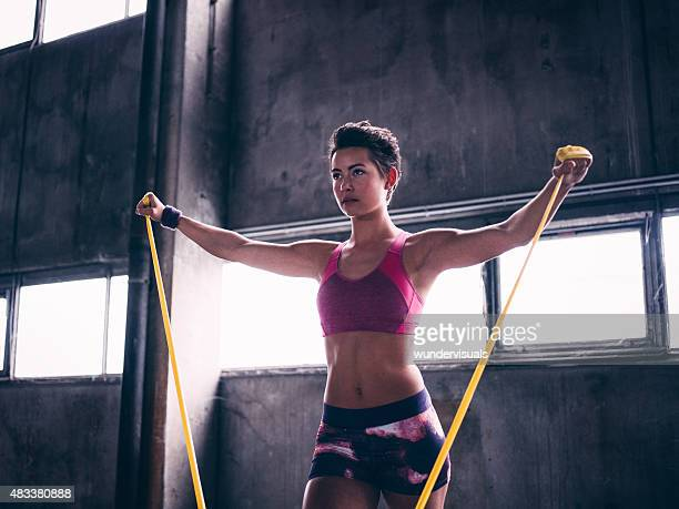 Young woman exercising with a resistance band