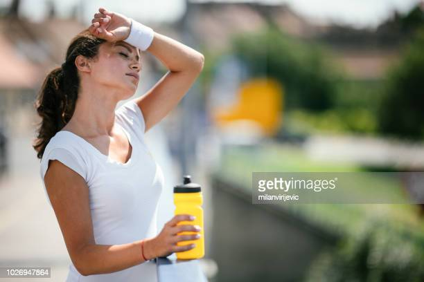 Young woman exhausted from training outdoors.