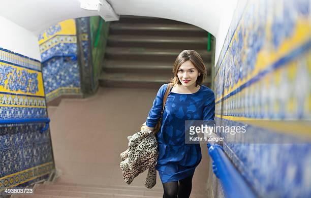 young woman exiting beautiful subway station
