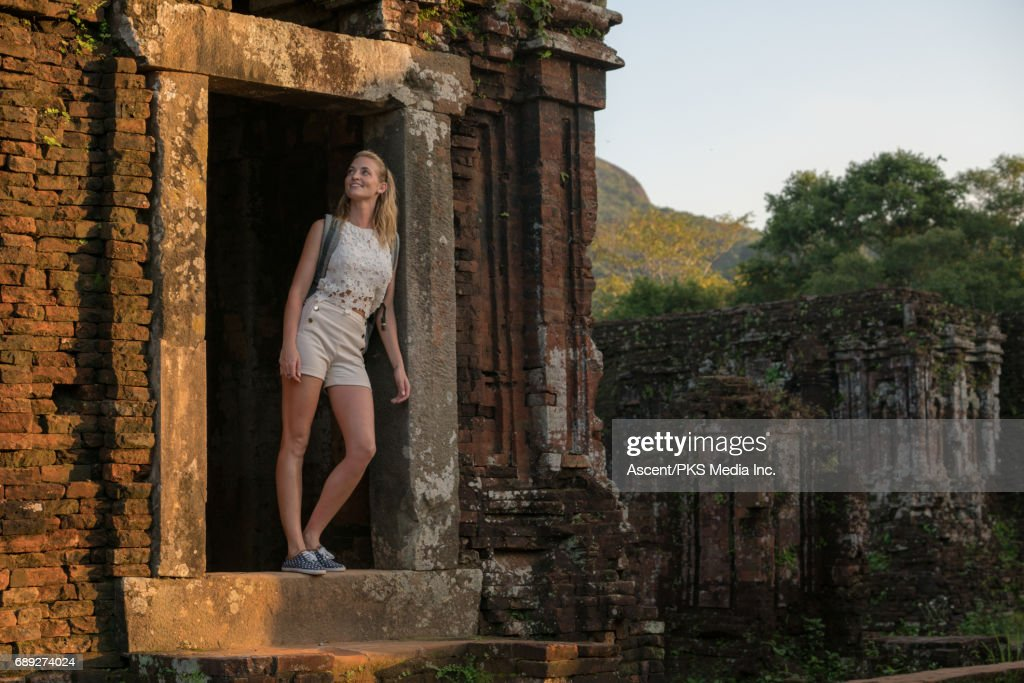 Young woman explores ancient ruins : Stock Photo