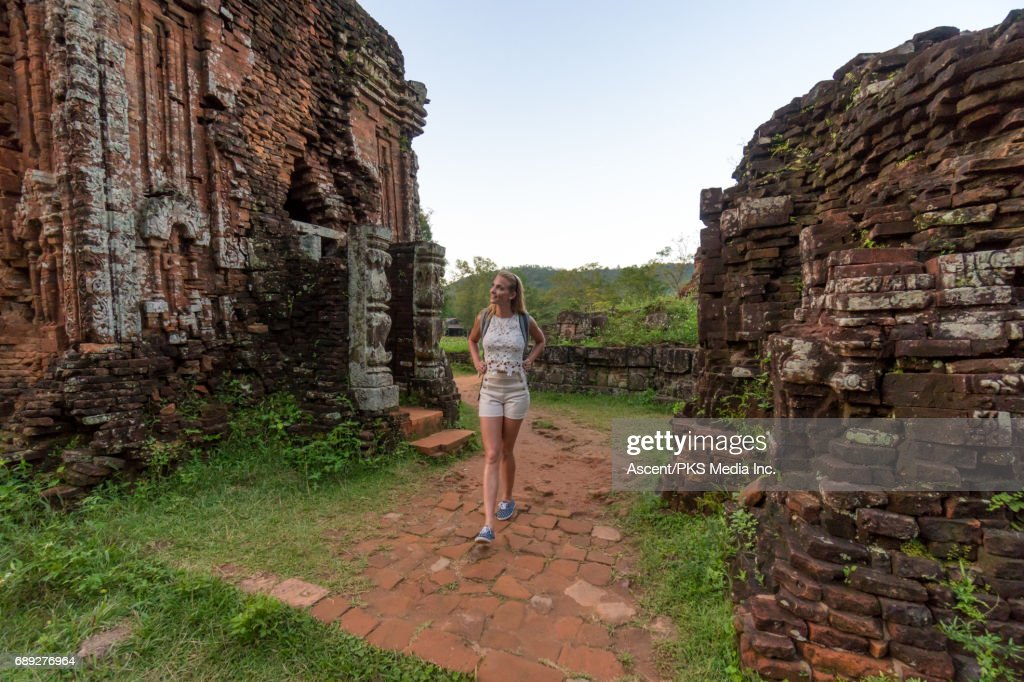 Young woman explores ancient ruins : Stock Photo
