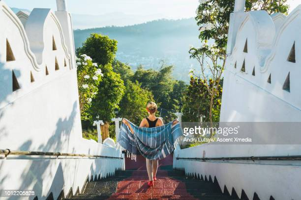 young woman explores buddhist temple grounds - kandy kandy district sri lanka stock pictures, royalty-free photos & images