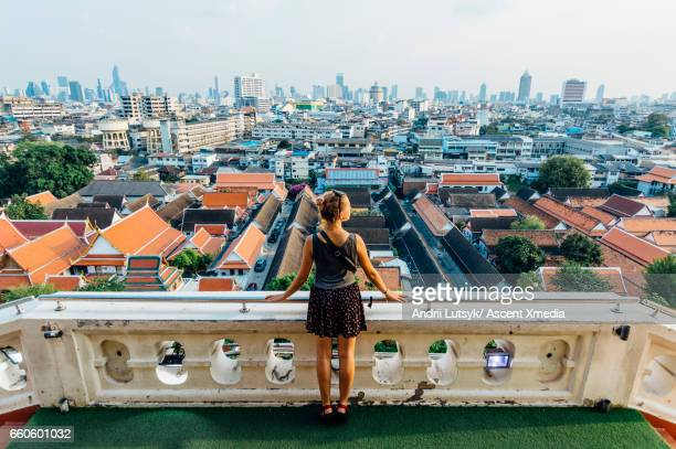 young woman explores city, looks out from overview - bangkok stock pictures, royalty-free photos & images