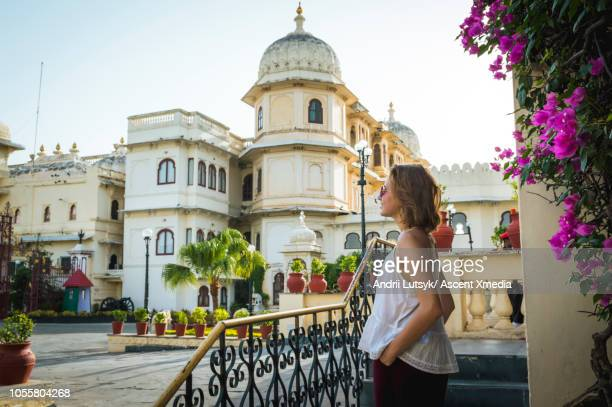 Young woman explores City Palace, Udaipur