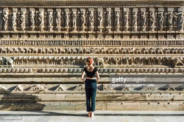 Young woman explores Jagdish Temple