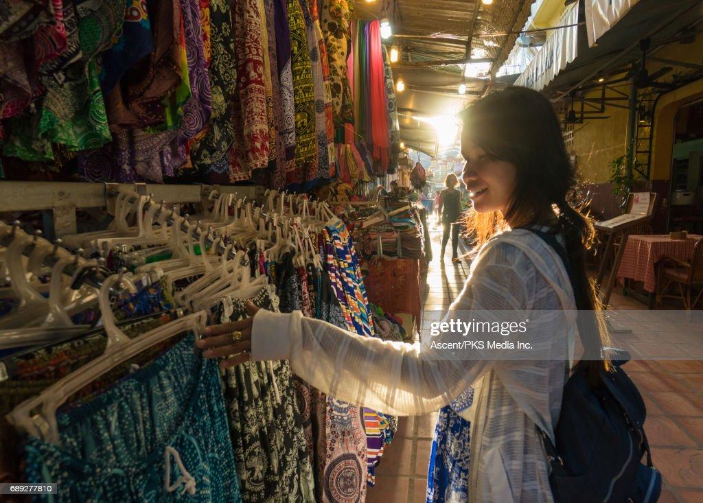 Young woman explores market, local colour : Stock Photo