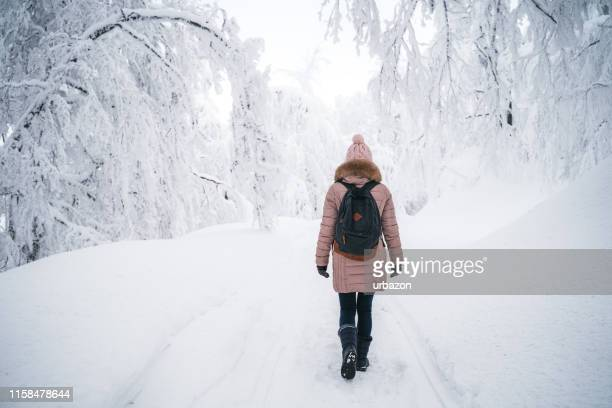 young woman exploring balkan mountains - deep snow stock pictures, royalty-free photos & images