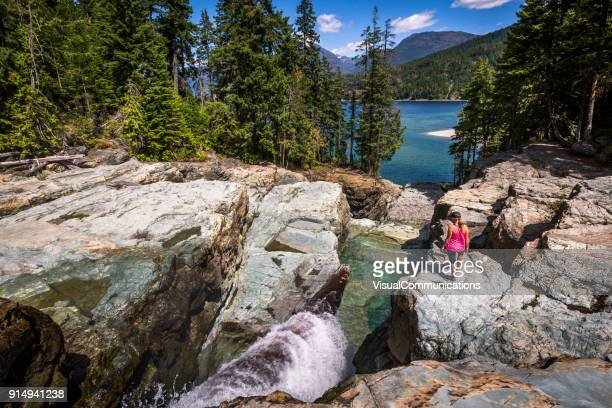 young woman exploring strathcona provincial park. - vancouver island stock pictures, royalty-free photos & images