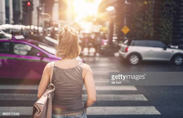 young woman exploring streets of bangkok - pedestrian crossing stock photos and pictures