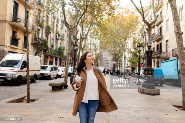 young woman exploring the city, barcelona, spain - avenue stock pictures, royalty-free photos & images