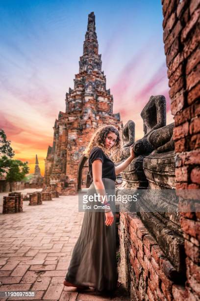 young woman exploring wat chai watthanaram temple in ayutthaya, thailand - ayuthaya province stock pictures, royalty-free photos & images