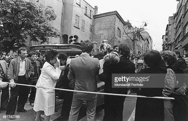 A young woman fainting at the funerals of the President of the Socialist Federal Republic of Yugoslavia Josip Broz Tito Belgrade 8th May 1980