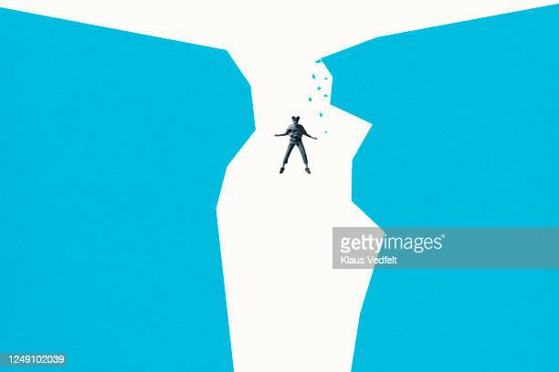 young woman falling amidst blue cliffs - graphic accident photos stock pictures, royalty-free photos & images